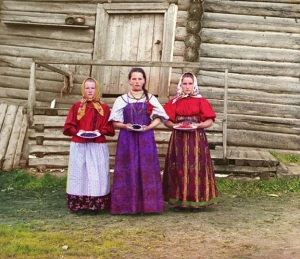 "Many of the images portray a bleak picture of the world, as here where it looks like ""hospitality"" is an unclear yet formal ritual that someone has forced their daughters to perform for the Tsar's Photographer. Others give a deeply real perspective on the lives of people at the time, as with this, the sort of general store with a nostalgic, bountiful, yet slightly shabby feel that managers at Whole Foods would give their first born children to reproduce."