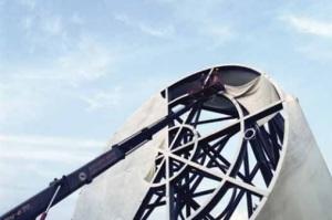 The outer material being removed [photo via http://prada-transformer.com/]