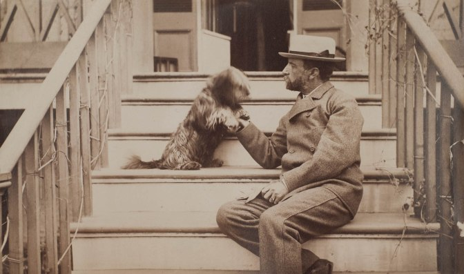 henry_adams_seated_with_dog_on_steps_of_piazza_photograph_by_marian_hooper_adams_ca-_1883